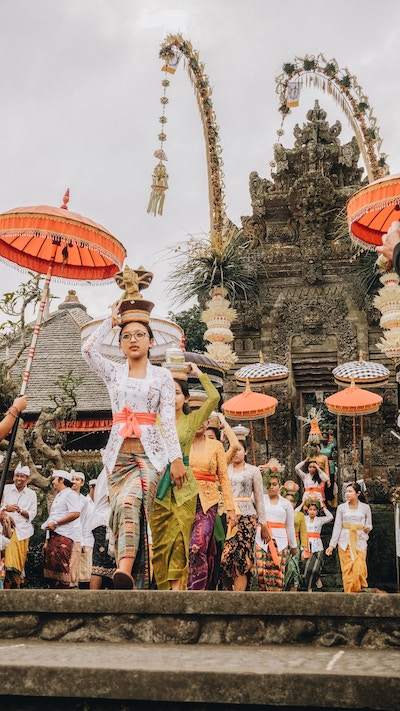 women wearing religious head-wear, leaving temple in Bali during a ceremony
