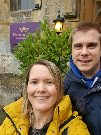 Couple standing outside the entrance to Thornbury Castle after winning a Weekender prize in our Weekly Draw